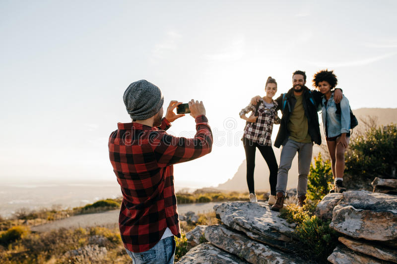 Group of people on hiking taking photographs royalty free stock photography