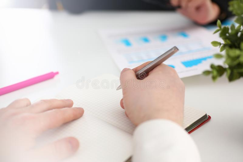 Group of people hold silver pen ready to make note stock photos