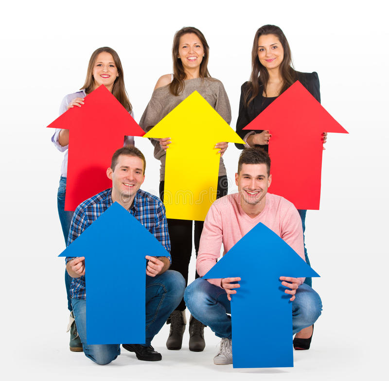Group of people holding arrows pointing up stock photo