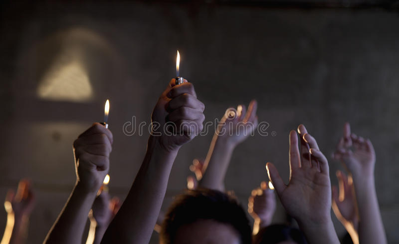 Group of people holding cigarette lighters at a concert stock photos