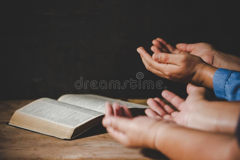 People holding hands praying worship believe. Group of people holding hands praying worship believe, devotional for prayer meeting concept royalty free stock photo
