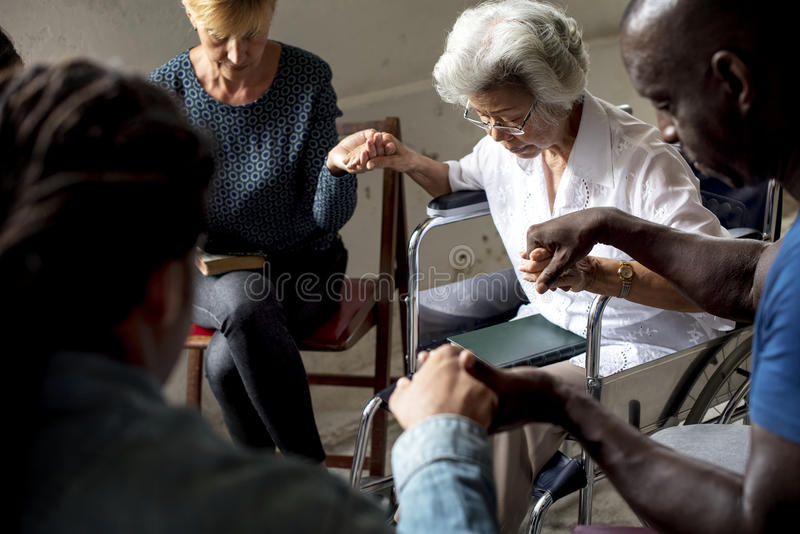 Group of people holding hands praying worship believe stock image
