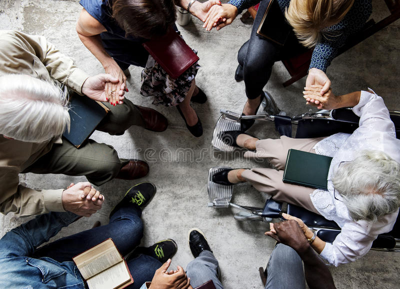 Group of people holding hands praying worship believe royalty free stock photography