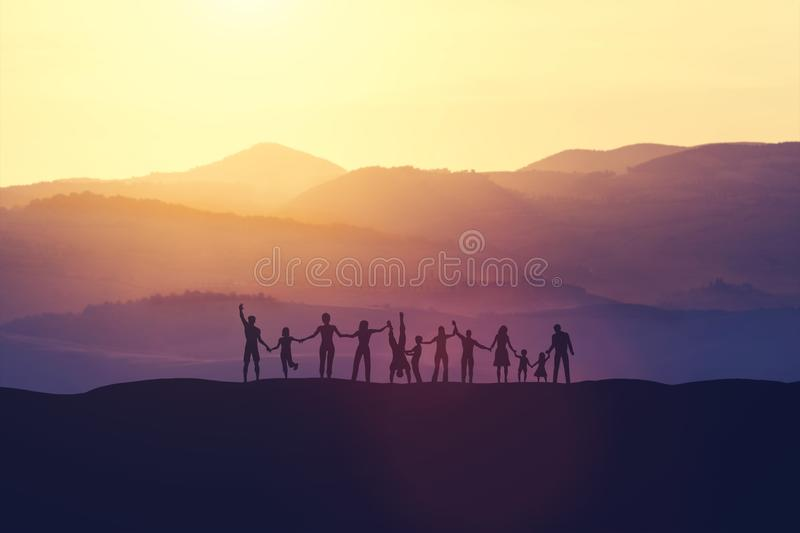 Group of people holding hands, standing on the hill. royalty free illustration