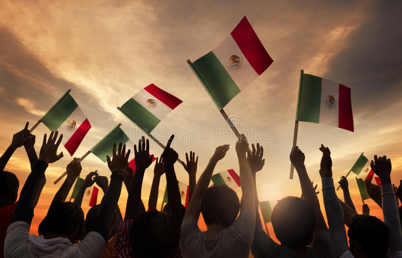 Group of People Holding National Flags of Iran.  royalty free stock image