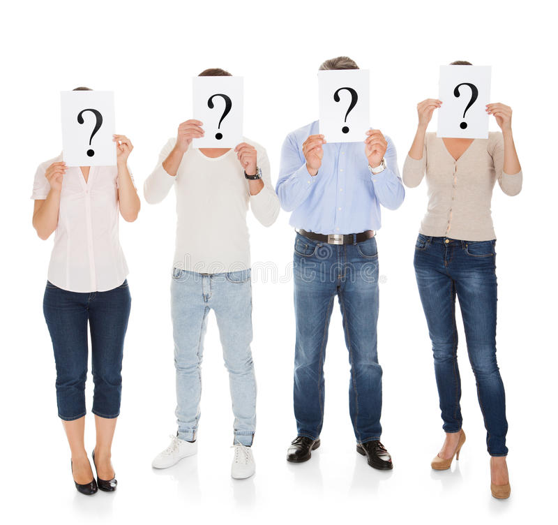Group Of A People Holding Question Mark Sign. In Front Of Their Face royalty free stock photo