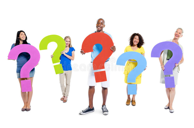 Group of people holding question marks.  stock image