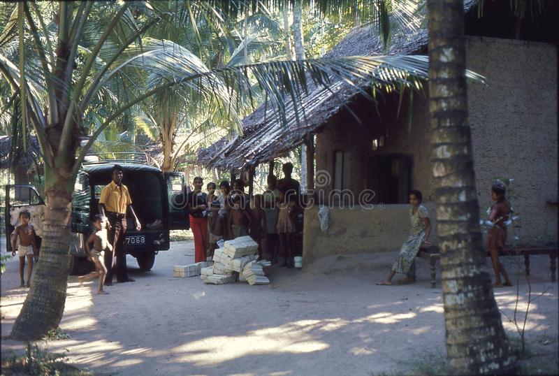 1977. Sri Lanka. A group of people i a small village. stock image