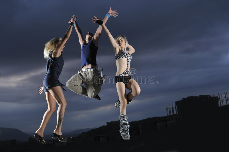 Group of people jumping in air stock photography