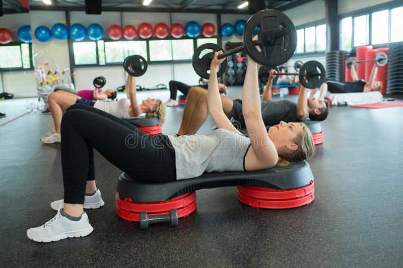 Group people lifting weights. Group of people lifting weights stock photo