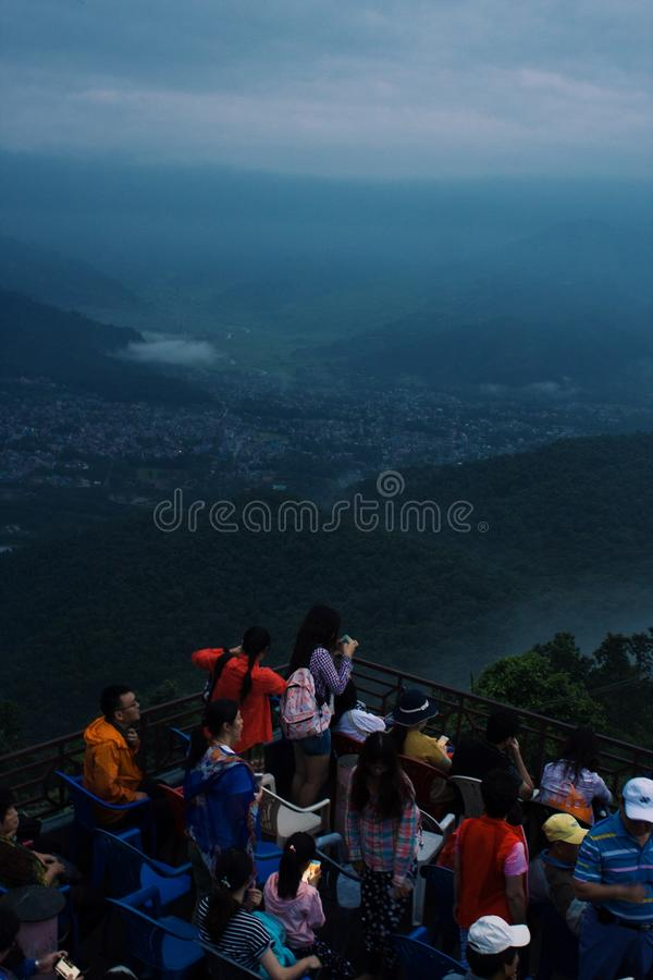 Group of People Looking at Mountain and City View royalty free stock photos