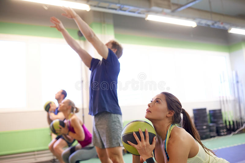 Group of people with medicine ball training in gym stock photography