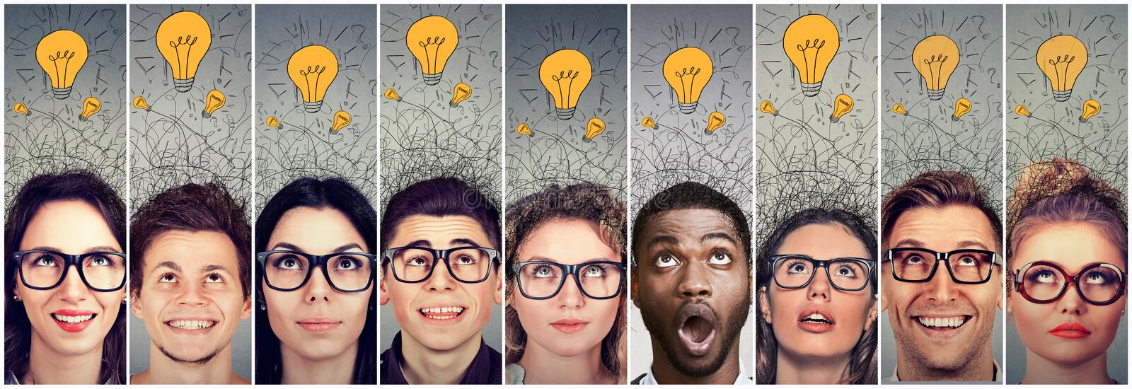 Group of people men and women with many ideas light bulbs above head looking up. royalty free stock photos