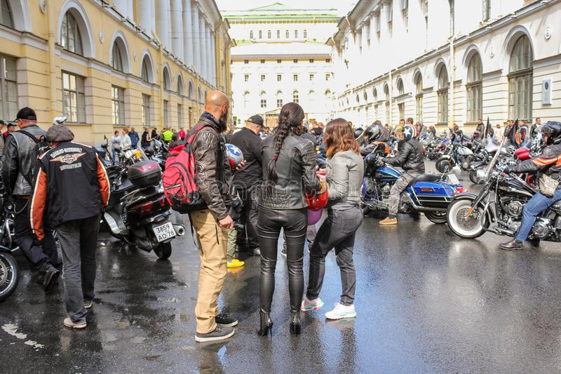 A group of people among motorcycles royalty free stock photos