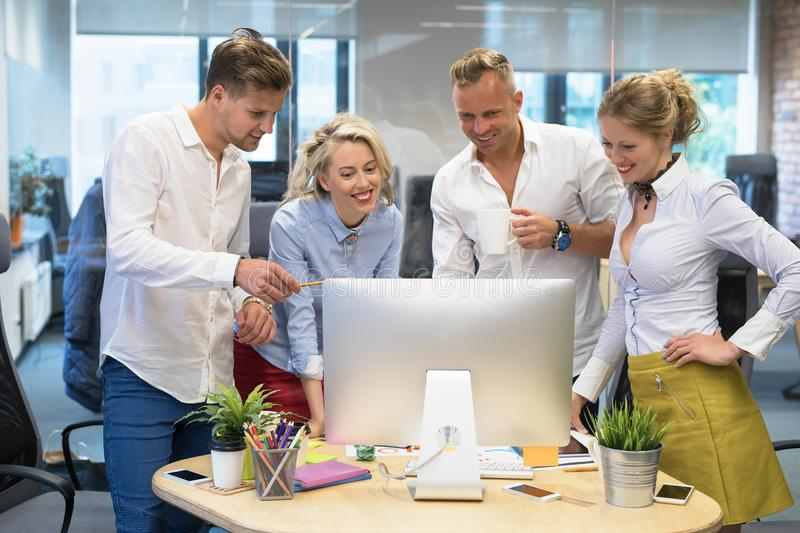 Group of people in office looking at computer royalty free stock photos
