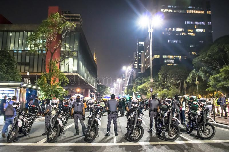 A group of people participates in a demonstration against President-elect Jair Bolsonaro. Hundreds of Brazilians, mostly students. Sao Paulo, Brazil, 30 October stock photos