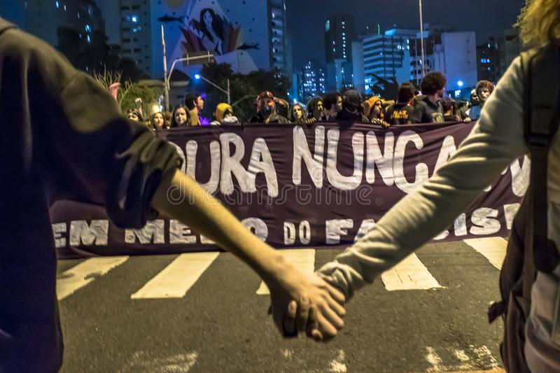 A group of people participates in a demonstration against President-elect Jair Bolsonaro. Hundreds of Brazilians, mostly students,. Sao Paulo, Brazil, 30 October royalty free stock photography