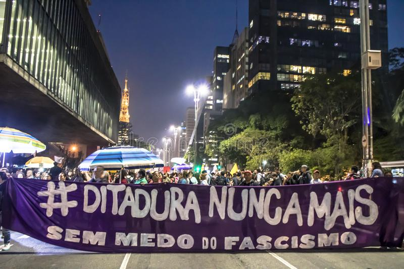 A group of people participates in a demonstration against President-elect Jair Bolsonaro. Sao Paulo, Brazil, 30 October 2018. A group of people participates in royalty free stock photo