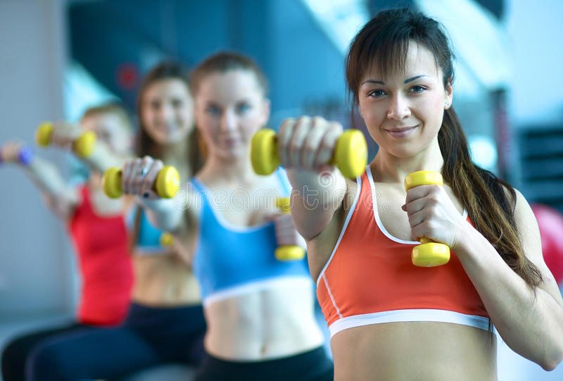 Group of people in a Pilates class at the gym royalty free stock photo