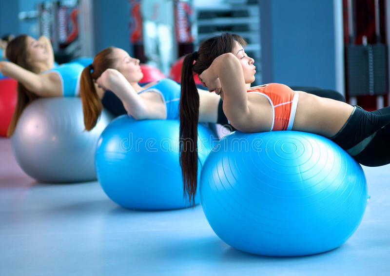 Group of people in a Pilates class at the gym royalty free stock images