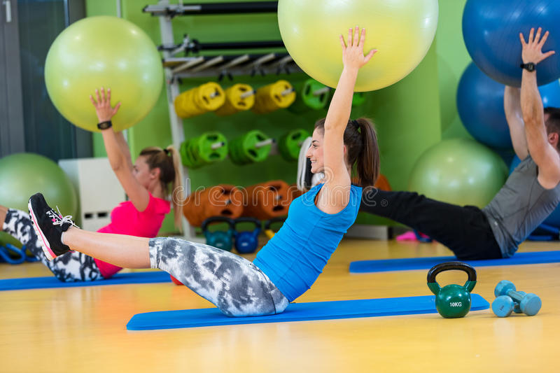 Group of people in a Pilates class at the gym stock image
