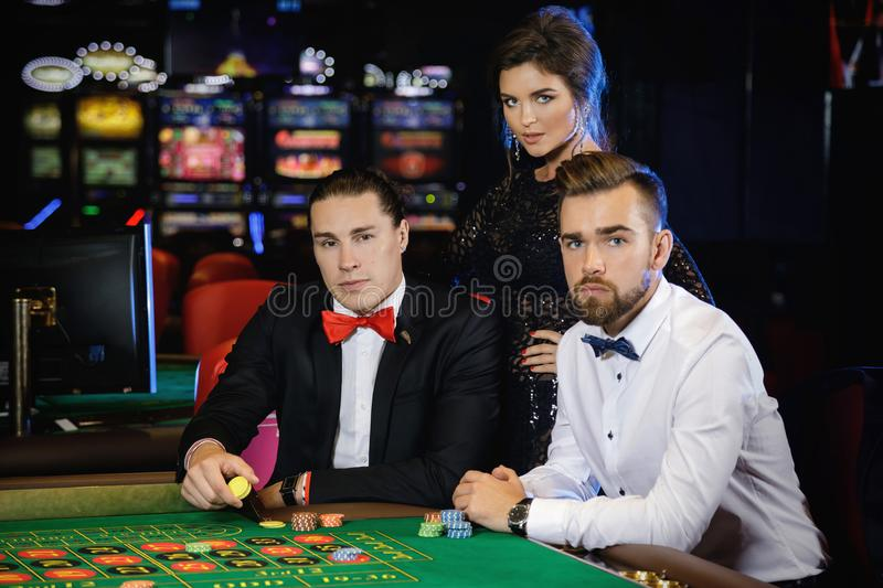 Group of people playing roulette in the casino royalty free stock photography
