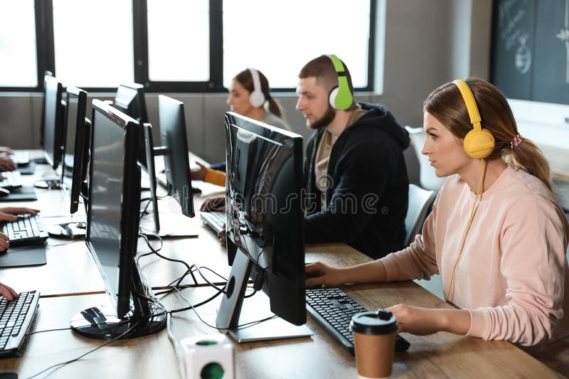 Group of people playing video games in cafe. Group of people playing video games in internet cafe royalty free stock photo