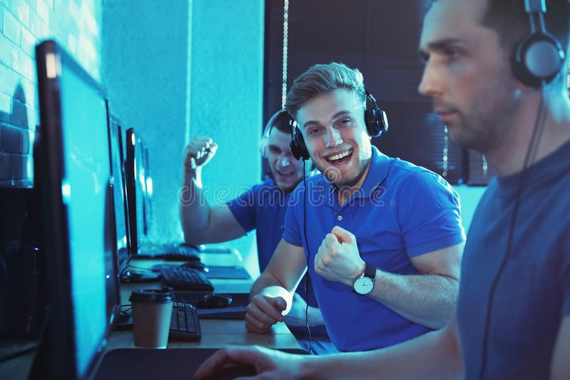 Group of people playing video games in cafe stock photo