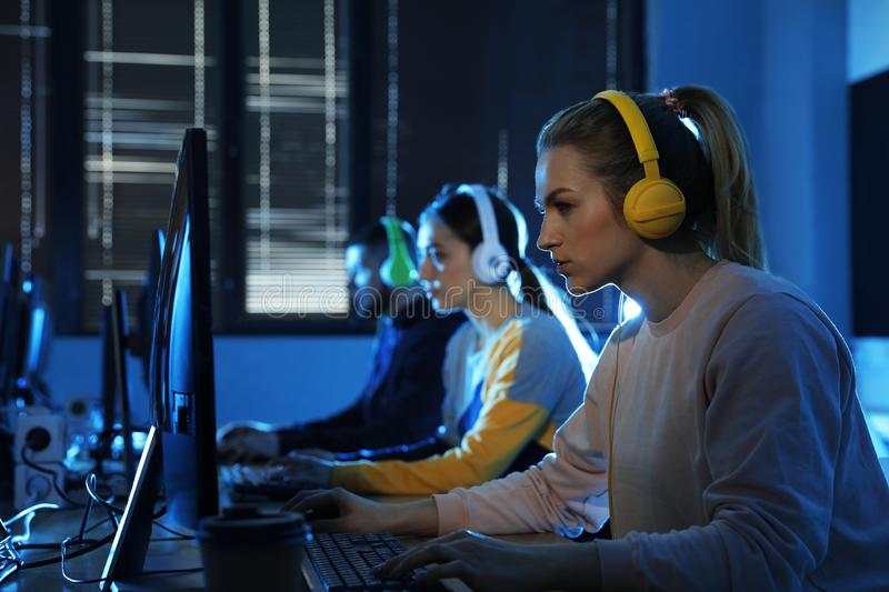 Group of people playing video games in cafe. Group of people playing video games in internet cafe stock images