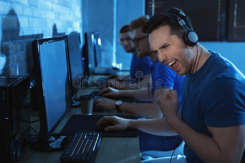 Group of people playing video games stock photos