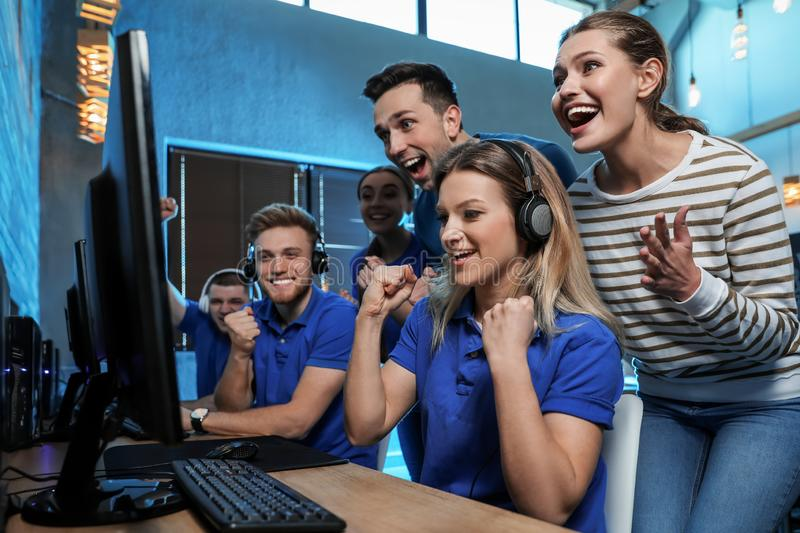 Group of people playing video games in cafe. Group of people playing video games in internet cafe stock photo