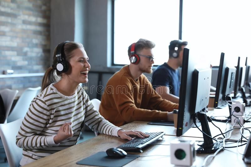 Group of people playing video games in  cafe royalty free stock photo
