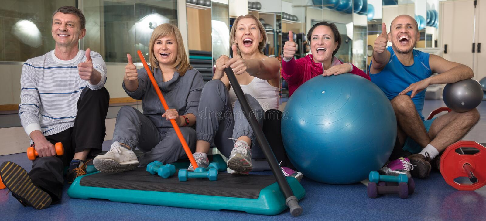 Group of people posing with gymnastic facilities at the gym royalty free stock photography