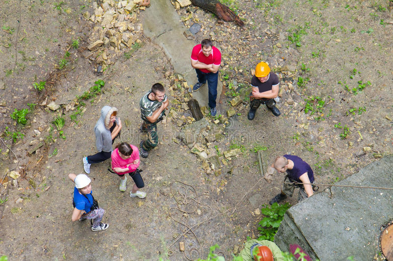 Group of people practice at a climbing training