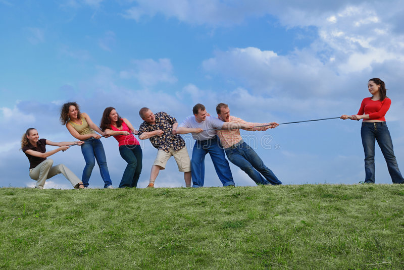 Group of people pulling the rope stock photo