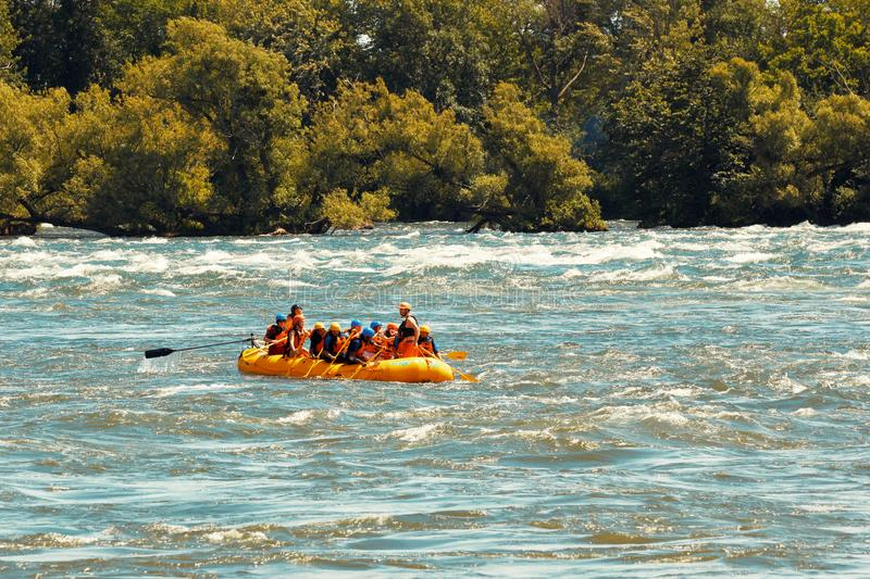 Group of people rafting in Lachine Rapids in Montreal, Quebec, Canada. Editorial royalty free stock photo