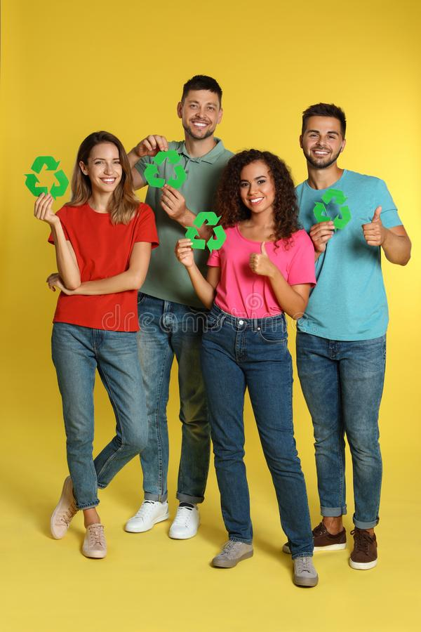 Group of people with recycling symbols stock photography