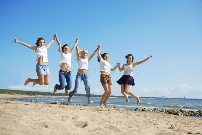 Group of people relaxing on the beach stock images