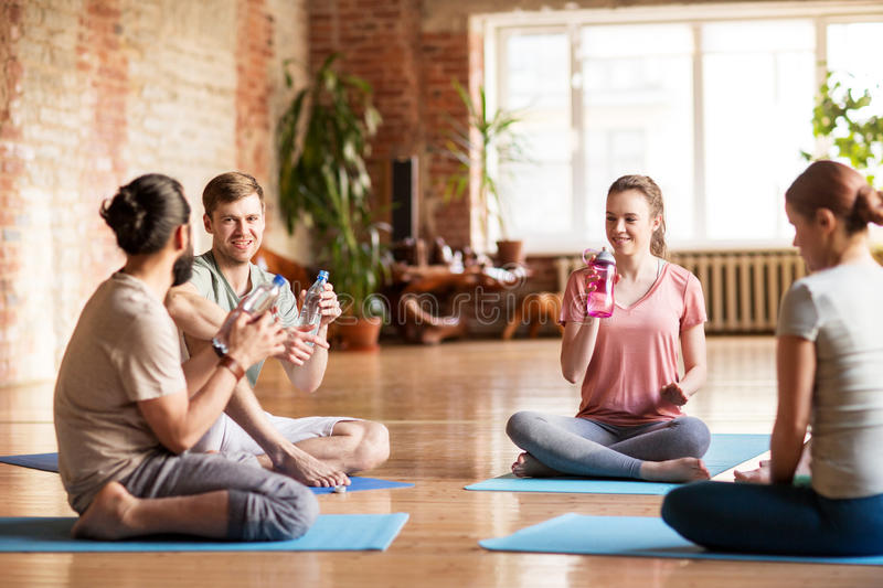 Group of people resting on yoga mats at studio stock photography