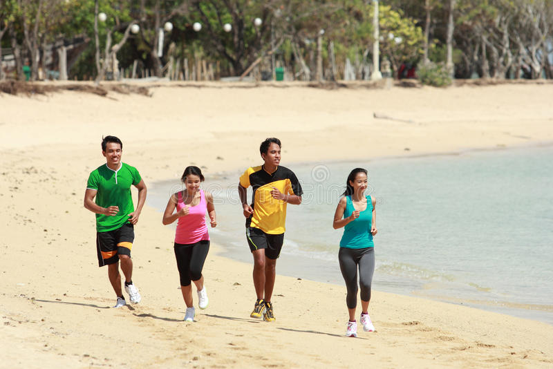 Group of people running on beach, Sport concept royalty free stock image