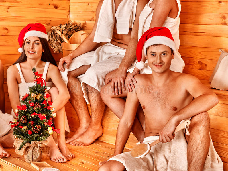 Group people in Santa hat at sauna. stock photo