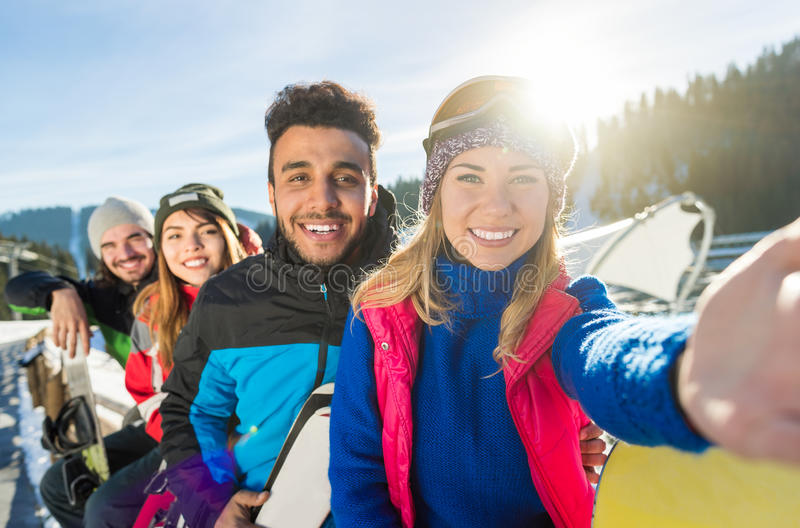 Group Of People Ski Snowboard Resort Winter Snow Mountain Happy Smiling Friends Taking Selfie Photo. Group Of People Ski Snowboard Resort Winter Snow Mountain stock image