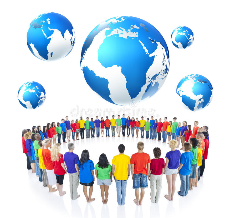 Group of People Standing around the Globe.  stock photo