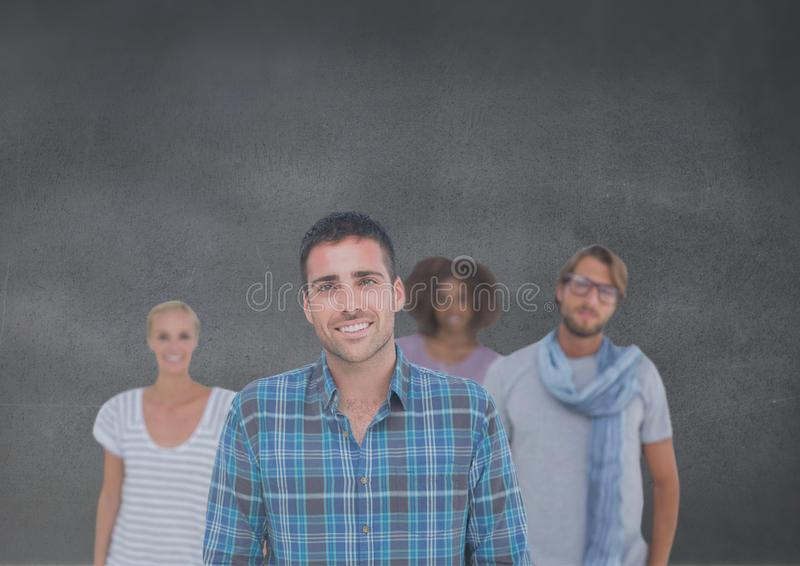 Group of people standing in front of blank grey background stock photos