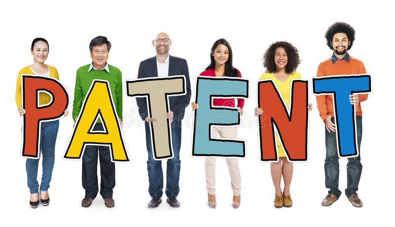 Group of People Standing Holding Patent Letter royalty free stock photo