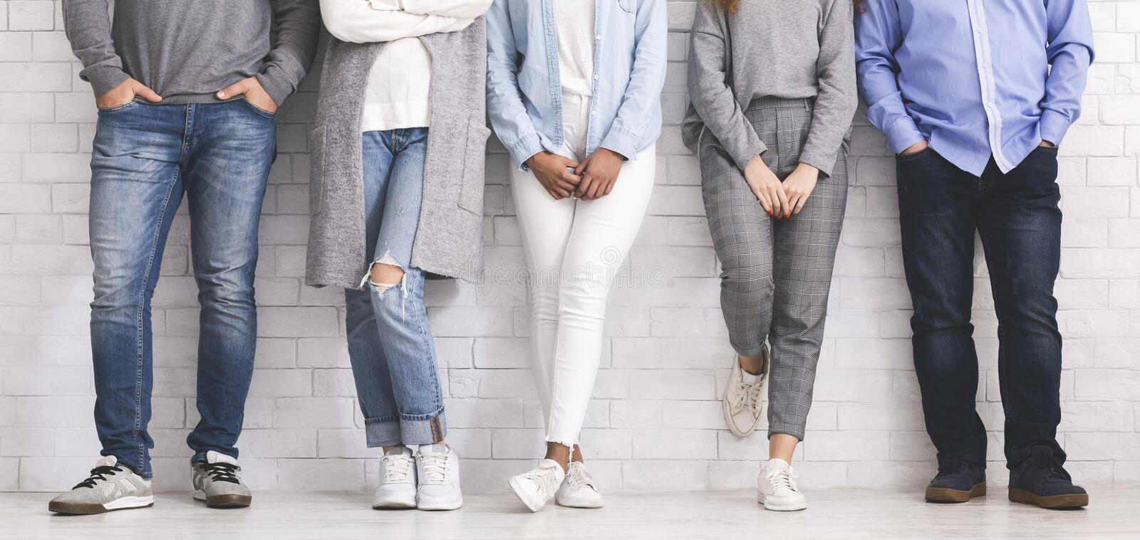Group of people standing in row, legs or young team stock photography