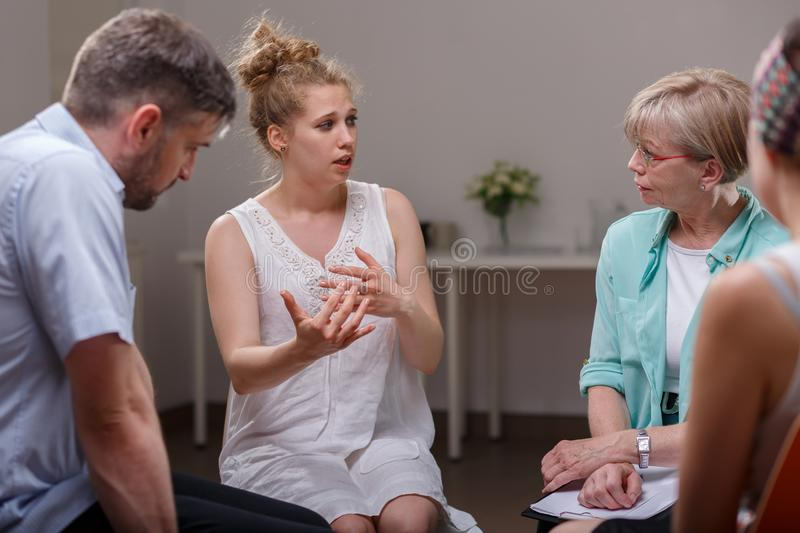 Group of people during therapy. Group of addicted people during psychological therapy stock photo