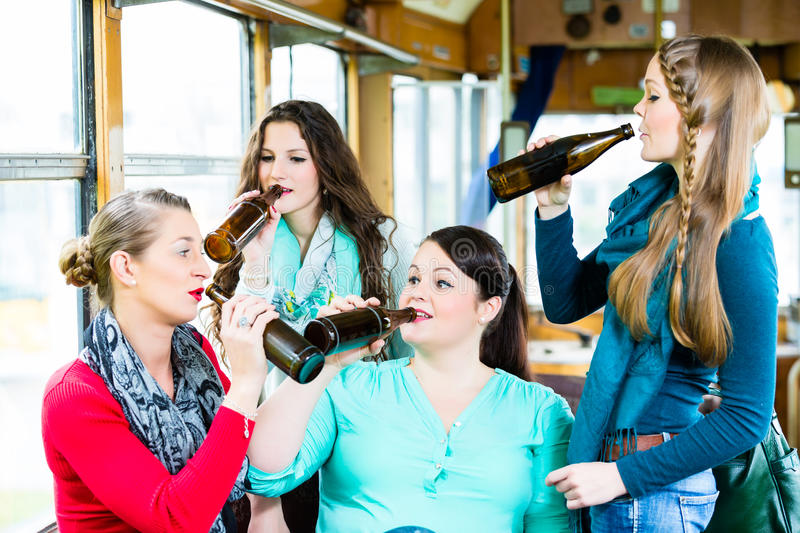 Group of people in tram bar having beer party stock images