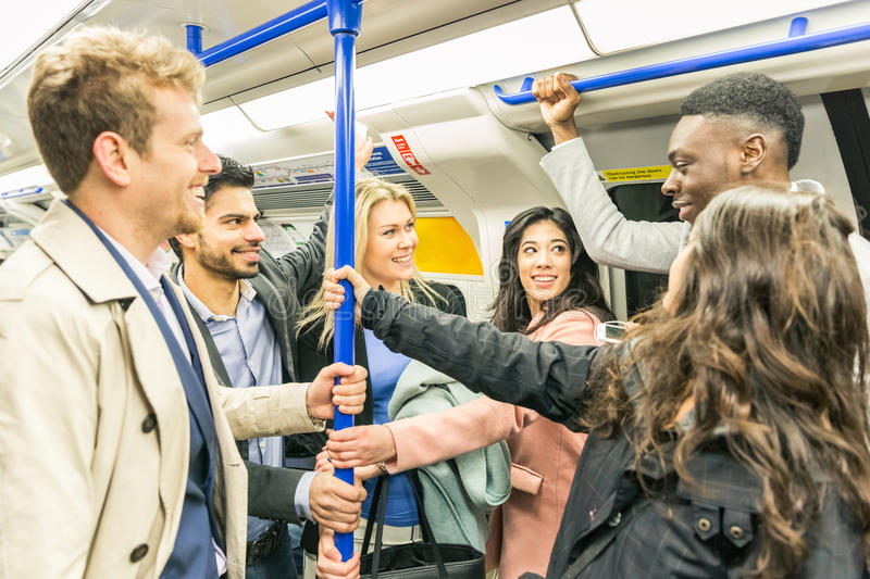 Group of people on tube train in London stock photography