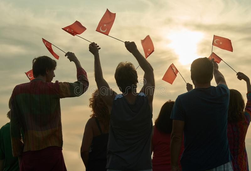 Group of people with turkish flags. Back view silhouette of turkish family royalty free stock photography